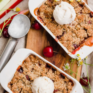 Easy 7-ingredient paleo cherry rhubarb crumble. Served in individual portion, for a quick and delicious summer dessert for 2. Oat-free, refined sugar-free, gluten-free, and vegan optional.