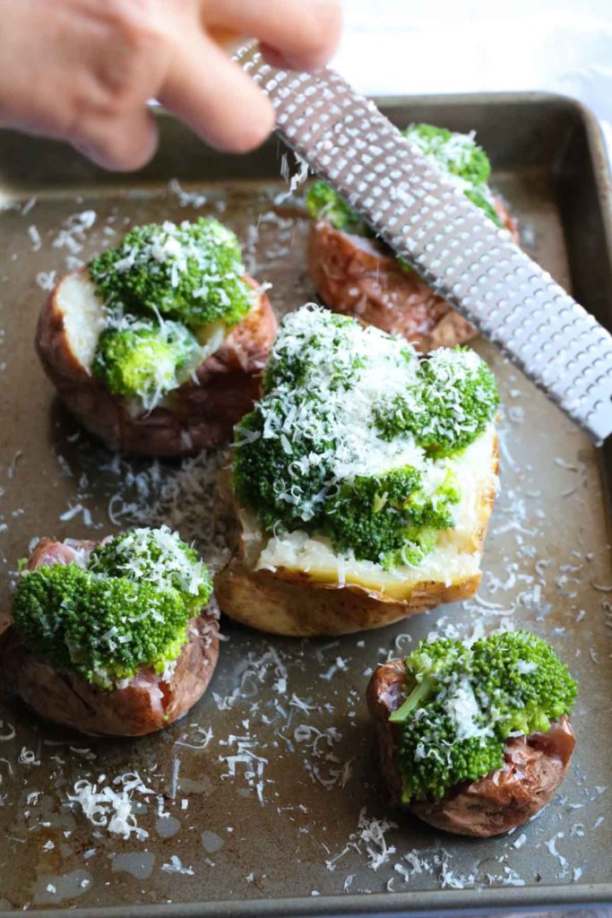 Parmesan Broccoli Loaded Baked Potato. A quick and healthy recipe using only 3 ingredients, broccoli, potato, and parmesan cheese. You can eat it as a side dish or the main event. I LOVE this recipe and have it at least once per week! | abraskitchen.com