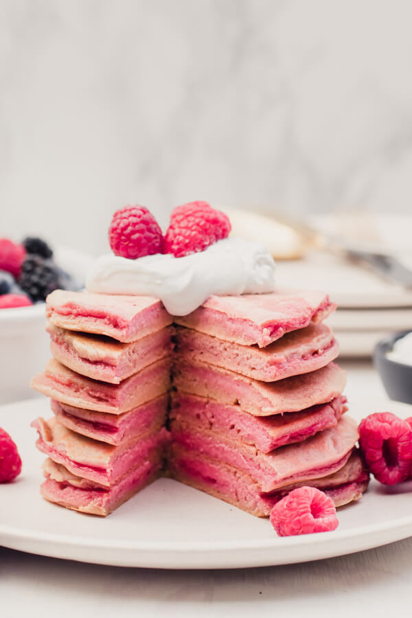 Super healthy real food pancakes, kissed with a touch of shredded beet to create gorgeous festive pink pancakes! Paleo, gluten-free, dairy-free, and so yummy!