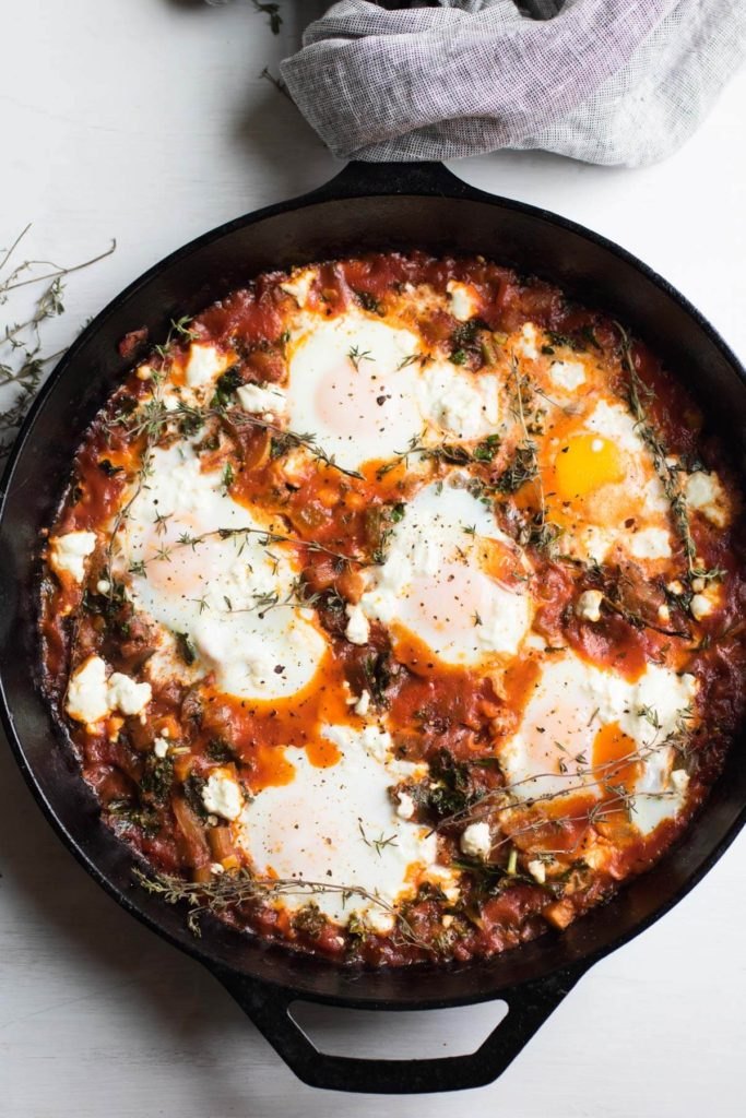 Ratatouille Shakshuka with Kale and Feta Cheese, eggs poached in a spicy tomato ratatouille sauce and topped with feta cheese. The PERFECT brunch dish. Gluten-free.
