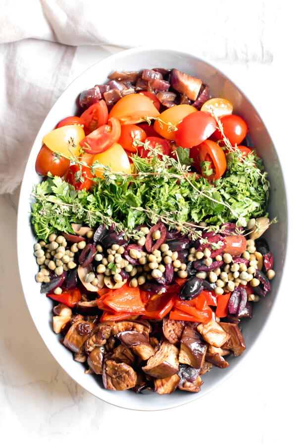 Nutty chewy (and super healthy) farro meet a bounty of fresh herbs, perfectly roasted eggplant, garden fresh tomatoes, and lots of kalamata olives! All tossed together in a garlic vinaigrette. This healthy vegan grain salad is easy enough to prepare and so delicious!