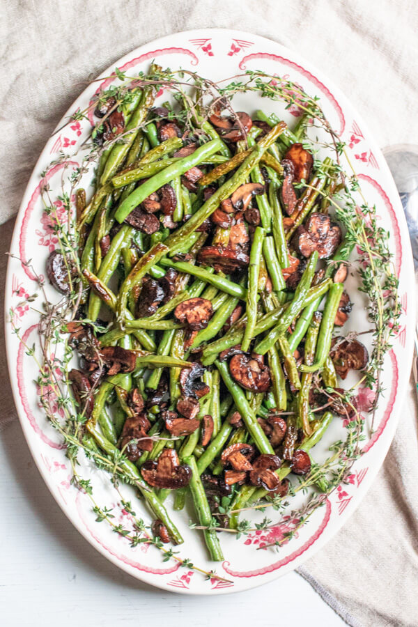 Roasted Green Beans and Mushrooms with a Vegan Creamy Onion Sauce on a large white platter