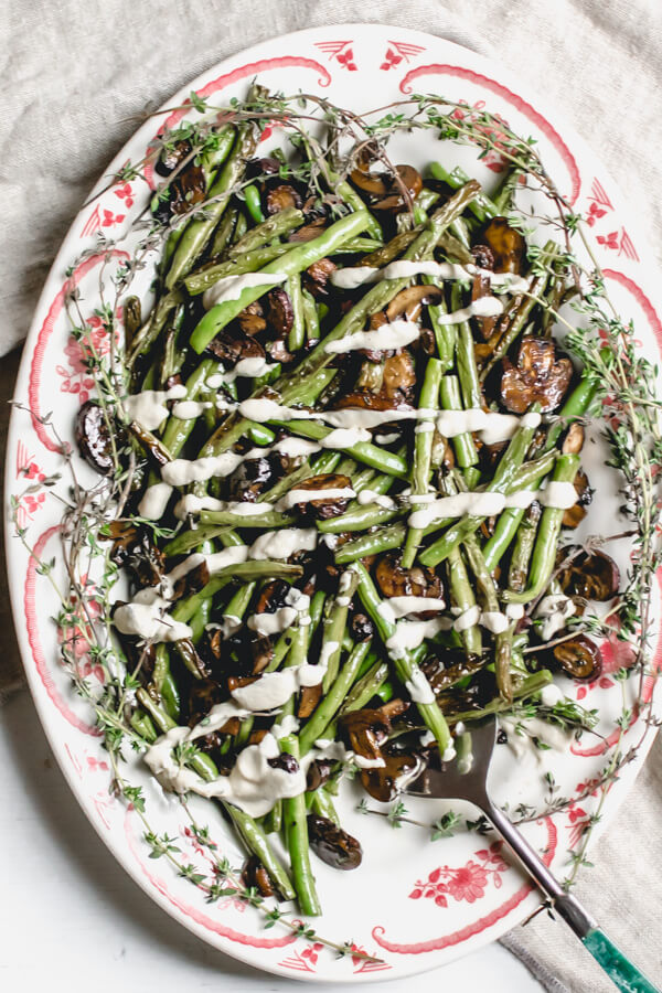 Roasted Green Beans and Mushrooms with a Vegan Creamy Onion Sauce on a white platter