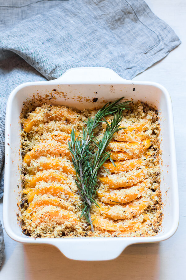 Roasted butternut squash coated with a shallot garlic butter and then topped with crunchy parmesan rosemary breadcrumbs.Thanksgiving side dish. Gluten Free (with GF breadcrumbs), Yummy! |abraskitchen.com #sidedish #Thanksgiving