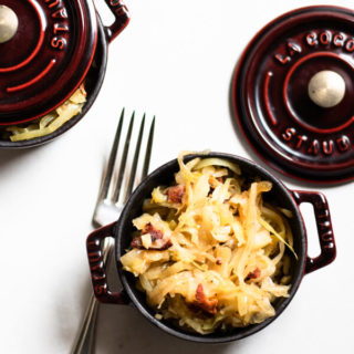 Easy Sauteed Cabbage, Sauerkraut, and Bacon on a white background