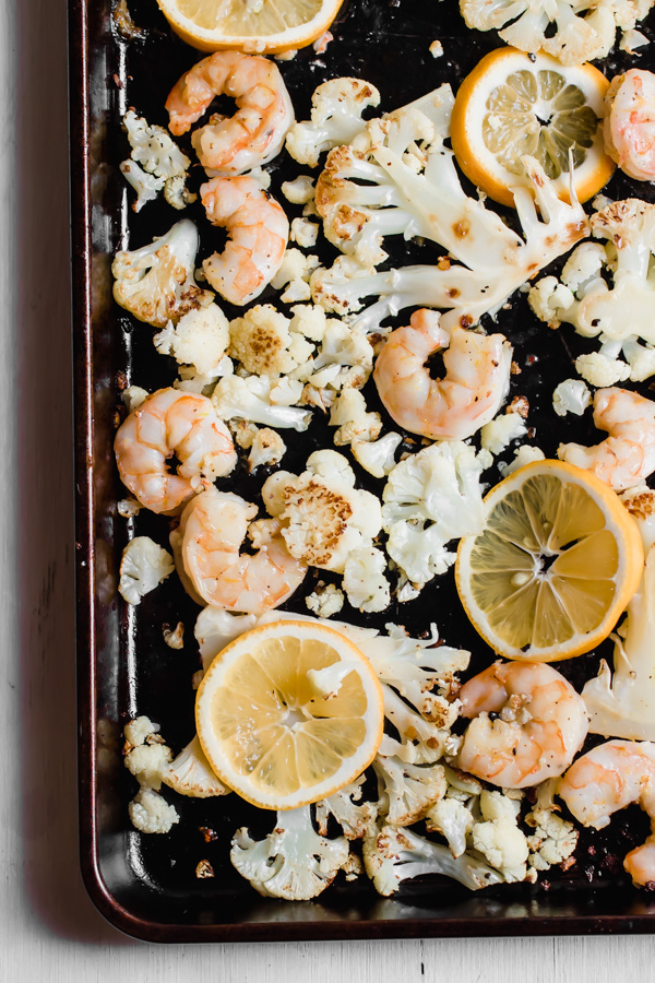 Perfectly roasted shrimp and cauliflower tossed with a bright and tangy Meyer lemon salsa. Dinner is done in 13 minutes! Paleo, gluten-free, quick, healthy, and easy.