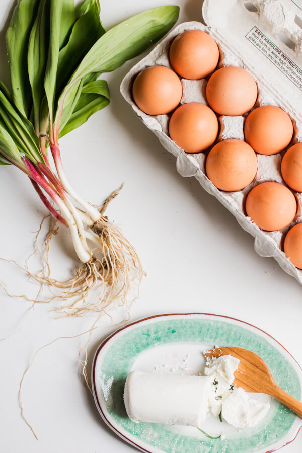 Ramps, Eggs, and Goat Cheese - Buttery soft scrambled eggs with fresh spring wild ramps and tangy goat cheese. A simple, yet decadent, breakfast. Only four ingredients, 5 minutes from start to finish.