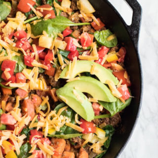 Southwestern sweet potato and ground beef skillet is loaded with fresh veggies and topped with cheese and avocado. A healthy, easy, and delicious dinner that your whole family will love. Ready in 30 minutes! Gluten Free. Real Food.