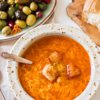 Healthy Spanish garlic soup, or Sopa de Ajo. A humble recipe using 7 simple ingredients and is ready in 15 minutes from start to finish. The most nourishing bowl of healthy restorative soup.