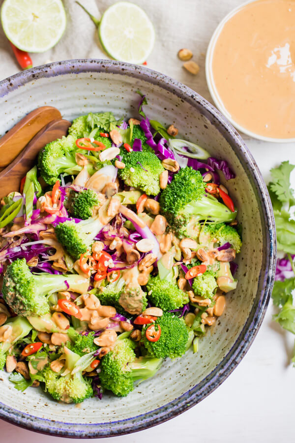 This super healthy and delicious Thai broccoli salad is loaded with colorful veggies and a mouthwatering spicy peanut butter dressing. This healthy broccoli salad is gluten-free, vegan and makes the perfect side dish or main dish any night of the week!