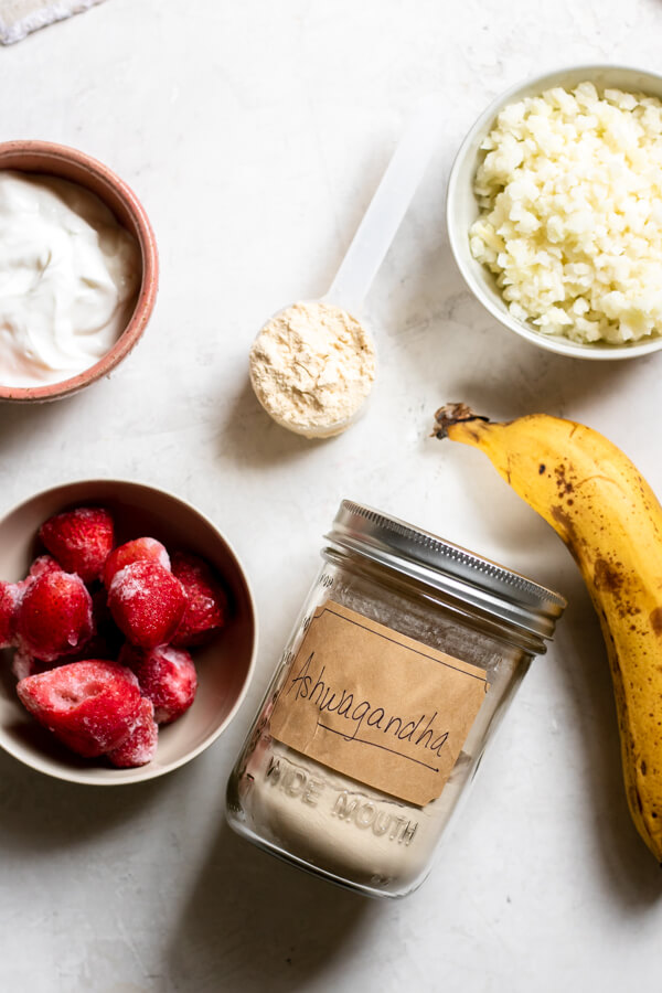 Ingredients for Strawberry Banana Adaptogen Smoothie on a white background