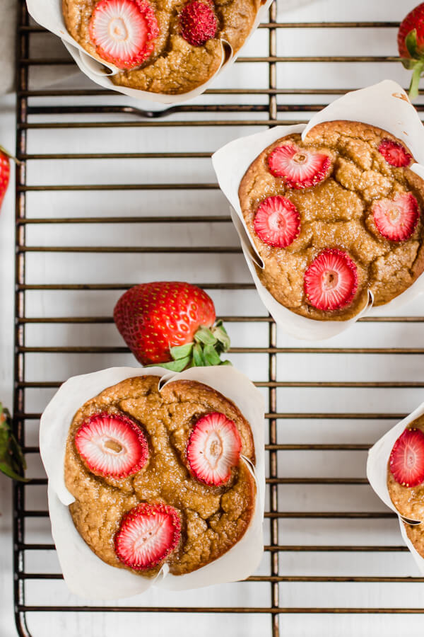 Gluten free, grain free strawberry banana bread muffins made with coconut flour. Free from refined sugar and grains, loaded with healthy fat and fiber. Seriously your new favorite healthy muffin.