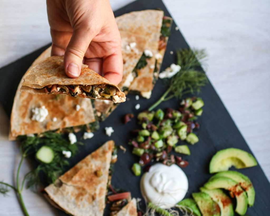 You will love this Swiss Chard and Feta Cheese Quesadilla topped with a cucumber olive salsa! A Mediterranean quesadilla that is addictivly good! |abraskitchen.com