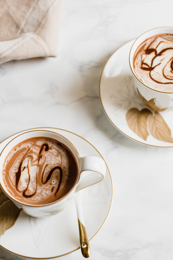 A rich and creamy vegan hot chocolate recipe touched with a pinch of fragrant cardamom and nutty tahini. Hot chocolate that is loaded with good for you ingredients and easily prepared in 5 minutes!