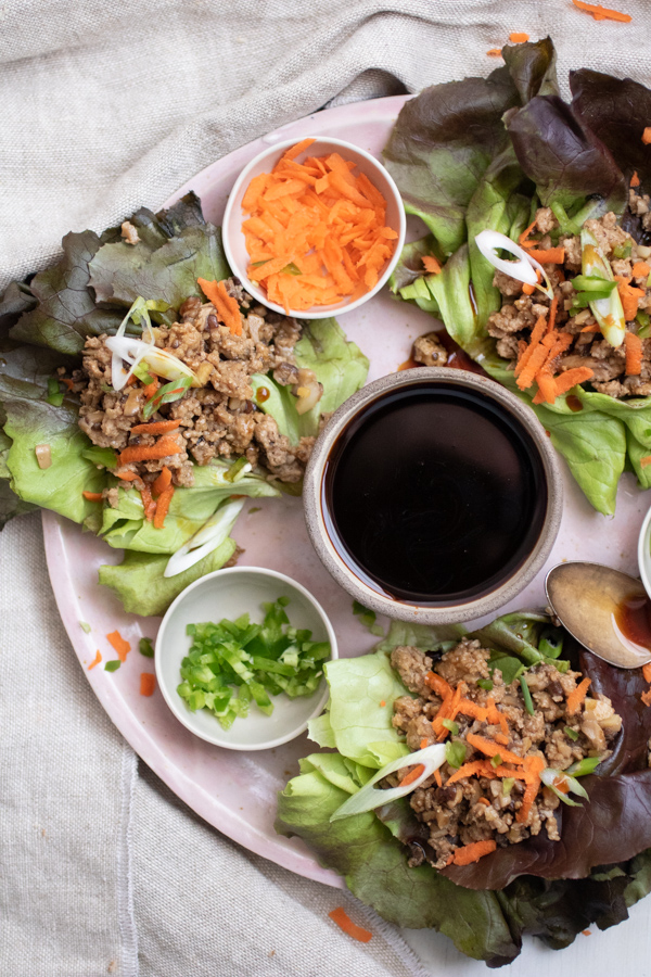 Teriyaki Turkey and Shiitake Mushroom Lettuce Wraps. Ground turkey is cooked to perfection with finely diced shiitake mushrooms and teriyaki sauce. Served in crunchy lettuce wraps with carrots, scallions, and diced jalapeno. Perfect for meal prep! A healthy paleo, gluten-free, grain-free, dairy-free recipe to add to your repertoire.