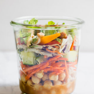 Healthy Thai Chickpea Jar Salad is the perfect meal prep lunch, this recipe makes 4 days of crazy town delicious protein-rich lunches! Creamy spicy peanut butter dressing with chickpeas, crunchy vegetables, cilantro, and salted peanuts. You have to put this on your meal plan!