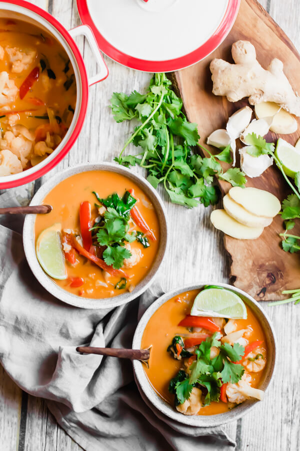 Thai Red Vegetable Curry ready in 30 minutes! A super healthy vegan, gluten-free, dairy-free, paleo meal loaded with good for you vegetables, Thai spices, and creamy coconut milk.