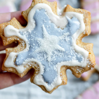 close up of almond flour sugar cookie in the shape of a snowflake