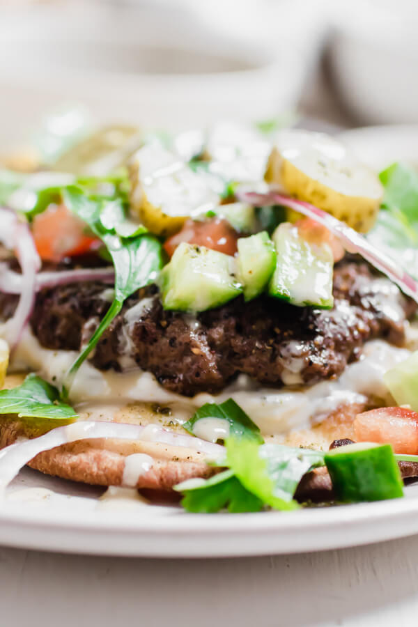 Shawarma spiced grass-fed beef burger grilled to perfection and layered on toasted naan bread with a yogurt feta cheese sauce, and a ton of veggie toppings. Epic is the most accurate word to describe this burger experience