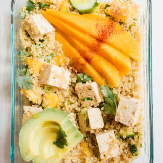 Sweet and spicy, tangy and luscious. This healthy vegan meal prep bowl is everything! Sweet mango with tangy lime and spicy chili powder, crunchy cucumbers, creamy avocado, tangy protein-rich tofu, and hearty quinoa. I'm happy to have this lunch on repeat all week long.