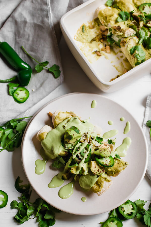 Easy Vegan Brussels Sprout and Mushroom Enchiladas with a creamy green enchilada sauce. A healthy homemade meal bursting with flavor your whole family will love!