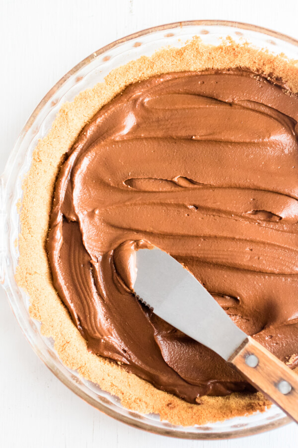 Creamy whipped peanut butter mousse piled high on top of sliced bananas and decadent chocolate avocado mousse, all nestled inside a graham cracker crust. The best peanut butter pie ever!