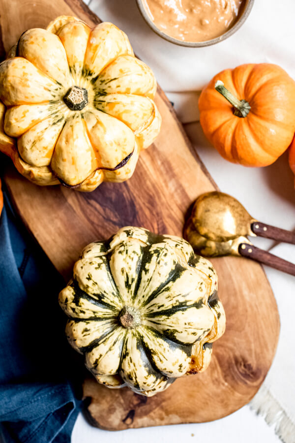 Vegan Peanut Butter Pumpkin Soup served in a pumpkin. 5 Simple Ingredients!