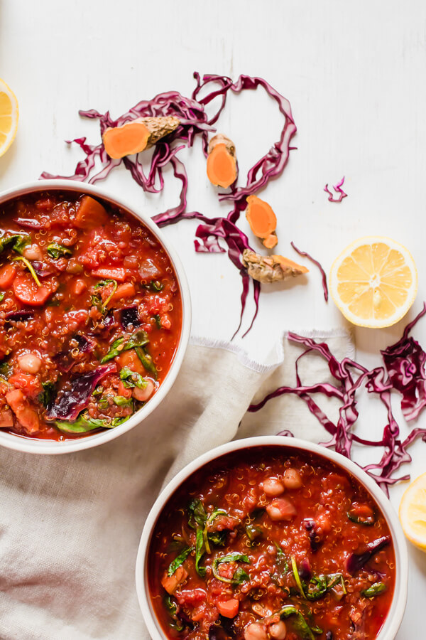This hearty vegetarian red cabbage quinoa stew is loaded with good for you vegetables that are sauteed with a hefty dose of anti-inflammatory turmeric and then finished with fresh lemon juice. It's zesty, warm, comforting, and delicious!