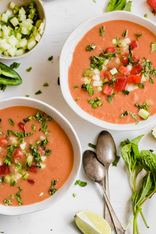 Watermelon Gazpacho - A light and refreshing chilled summer soup, savory with a touch of sweetness from the watermelon. Watermelon, tomatoes, cucumber, jalapeno, scallions, and fresh herbs are the stars of this healthy soup!
